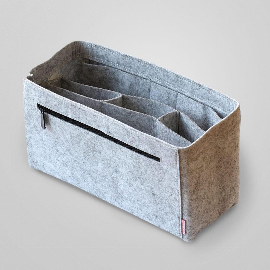 Der Taschenorganizer - eine tolle Lösung für alle, die nicht länger ihre Taschen nach Schlüssel, Handy, Lippenstift & Co. hektisch durchwühlen wollen. Viele kleine Fächer schaffen verlässliche Ordnung und Struktur in Taschen.  Details & Bestellung